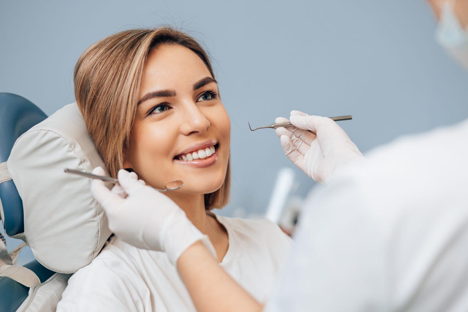 Beautiful Young Woman In Dental Examination